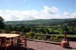 Our Bistro overlooks the valley encroached by an impressive escarpment and below the river Usk