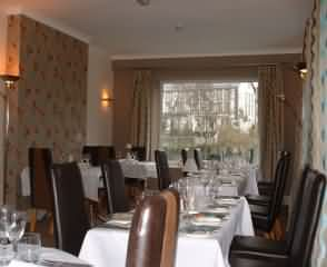 The comfortable and well appointed dining room directly overlooks the River Irfon